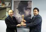 Zavari presents the 14th Iranian Cinema Celebration Award to Leo Lo in Hong Kong